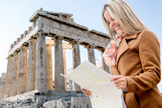 Tourist in front of the Acropolis with map