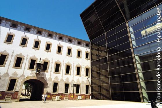 The glassy front and the former hospital building of the Centre du Cultura contemporania de Barcelona