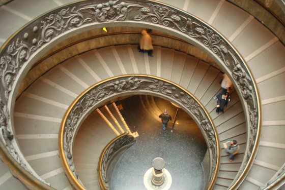 Stairs of the museo pio clementino with antique artwork in Rome