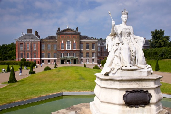 Kensington Palace with Queen Victoria statue nearby the sunken gardens