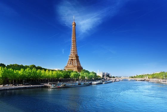 Eiffel tower in Paris with a view from the water of the Seine